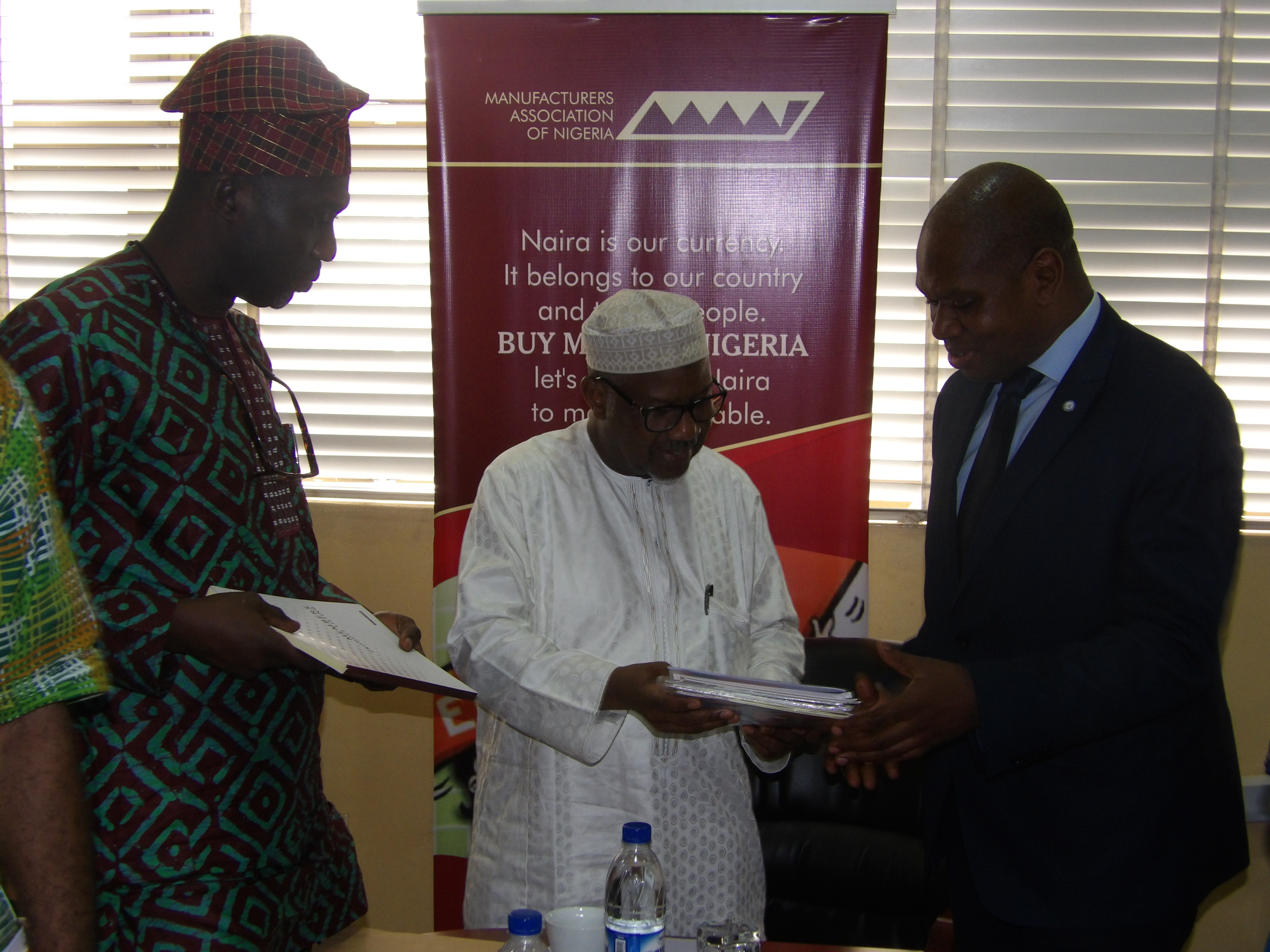 MAN President giving MAN Publications to UNIDO representatives on a courtesy visit